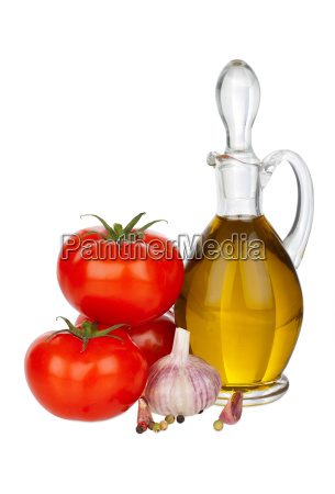 carafe of olive oil tomatoes and