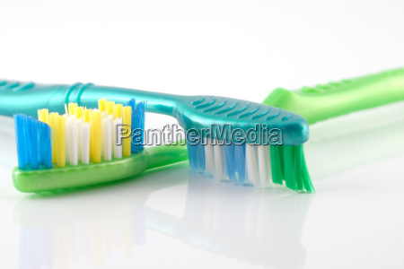 two tooth brushes over white