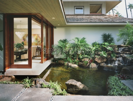 exterior details and luscious pond