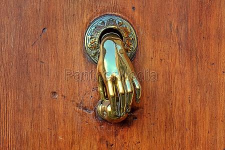 hand shaped golden door knob on