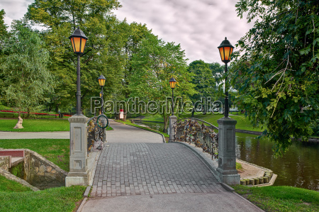 small bridge with lampposts across canal