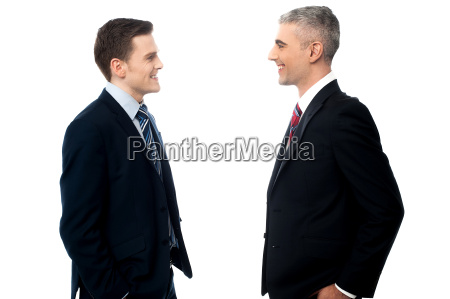 smiling businessmen in discussion