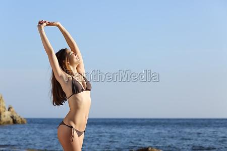 beautiful fitness woman body wearing a