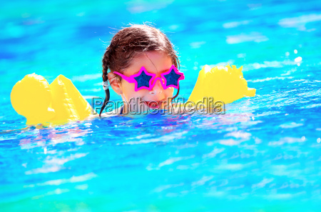 cute little baby swiming in the