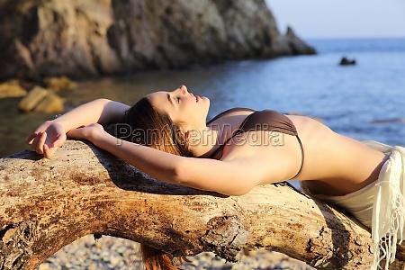 beautiful woman sunbathing on a paradise