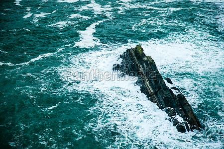 irish coast breaking wave in the