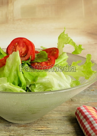 bowl with lettuce and tomatoes