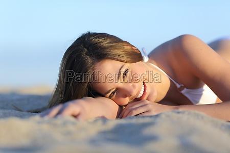 portrait of a beautiful woman sunbathing