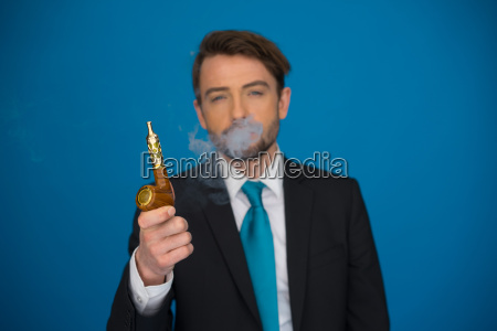 businessman with e cigarette wearing a