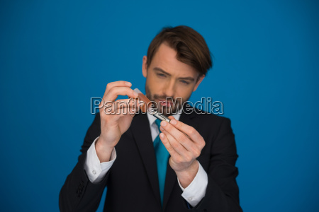 businessman topping up his e cigarette