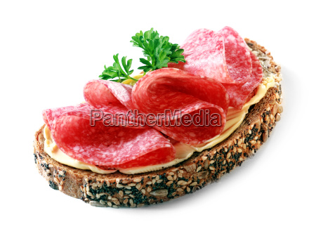 tasty appetizer of salami on wholewheat