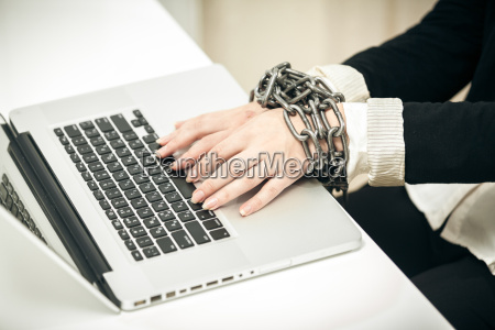 photo of female hand chained up