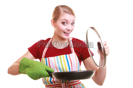 happy housewife or chef in kitchen