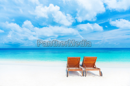 two empty sunbed on the beach