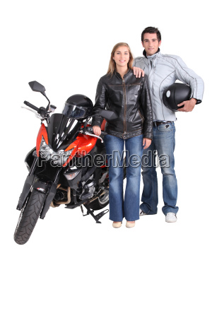 biking couple with a red motorcycle
