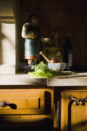 statue and cooking supplies on kitchen
