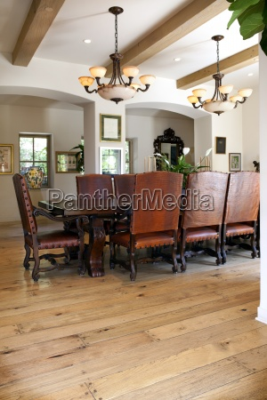 arranged dining table on hardwood floor