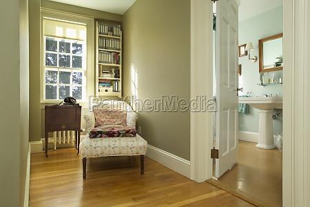 long armchair on hardwood floor in