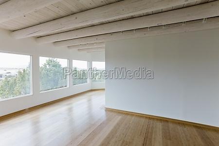 ceiling beams and hardwood floor in