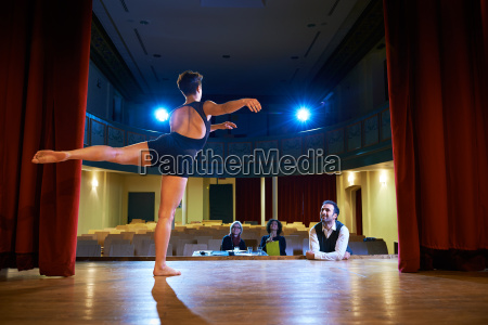 woman dancing for audition with jury