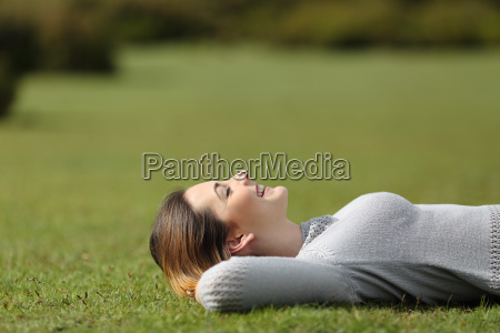 beautiful woman resting on the grass