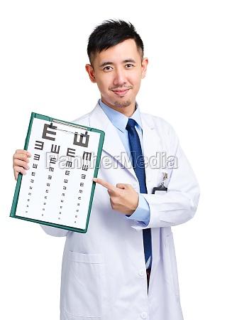 male doctor keeping optometry chart