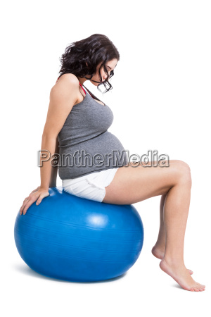 attractive pregnant woman on a blue
