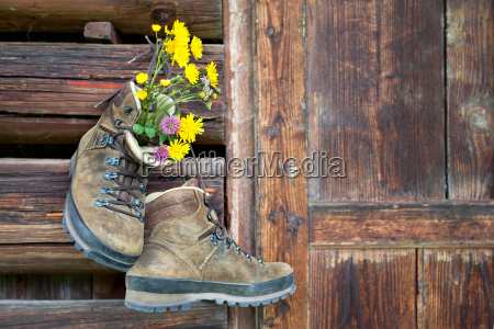 hiking boots on rustic wooden wall