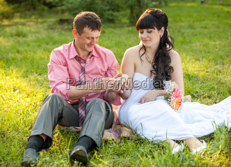just married couple changing rings on