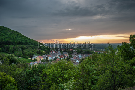 village under the hill at sunset
