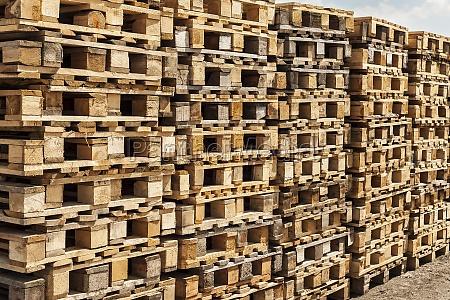 wooden transport pallets in stacks