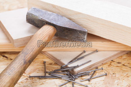 hammer with nails on a wooden