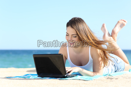 happy teenager girl browsing social media