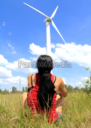 girl near a wind turbine