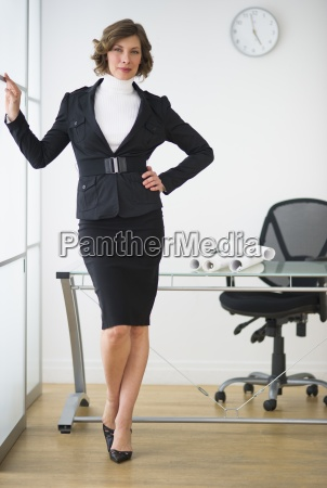 portrait businessman confidence office formalwear leaning