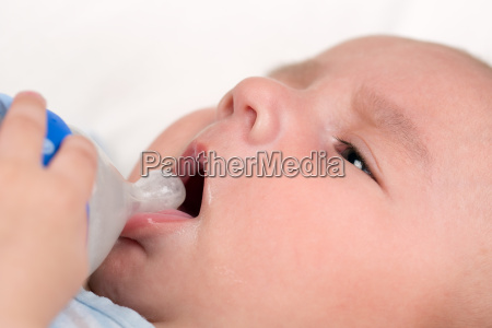 baby opens mouth and drinks milk