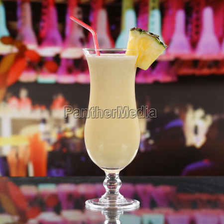 pina colada cocktail in a bar