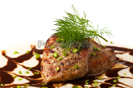 small veal steak on a sauce
