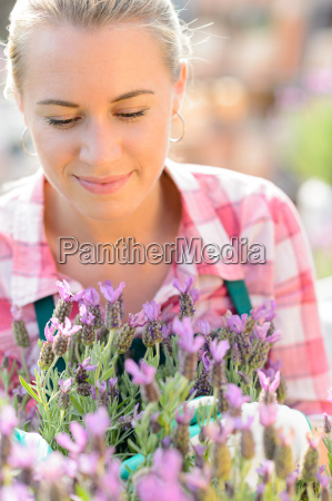 garden center woman with purple potted