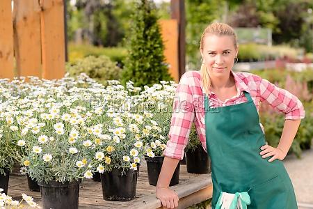 garden center woman worker potted daisy