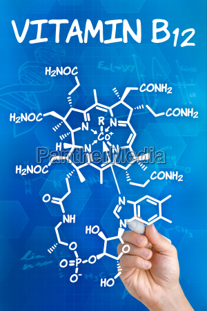 hand draws chemical structural formula of