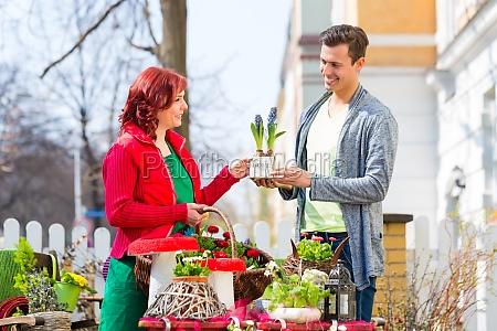 costumer buying flower in flower shop