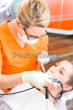 patient having dental tooth cleaning at