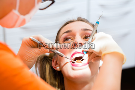 patient having deep dental tooth cleaning