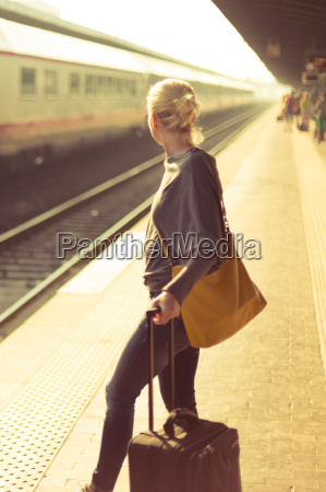 lady waiting at the railway station