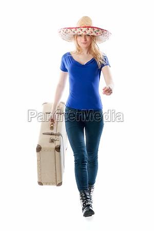 blond dziewczyna z podrozy walizka