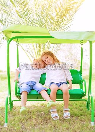 happy kids on the swing