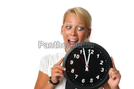 woman holding a wall clock