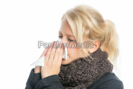 sick blonde woman with handkerchief