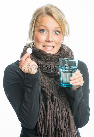 sick blond woman effervescent tablet dissolves